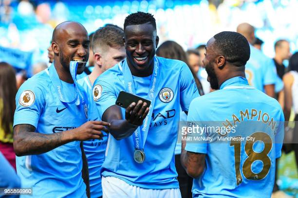 Manchester City's Fabian Delph Benjamin Mendy and Raheem Sterling celebrate after the Premier League match between Manchester City and Huddersfield...