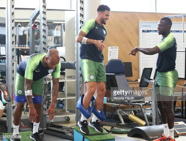 Manchester City's Fabian Delph Kyle Walker and Benjamin Mendy during training in the gym at Manchester City Football Academy on August 15 2018 in...