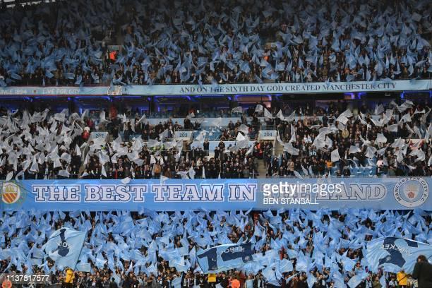 Manchester City's fans wave flags before the UEFA Champions League quarter final second leg football match between Manchester City and Tottenham...