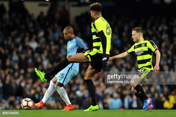 Manchester City's Fernandinho and Huddersfield's Philip Billing and Jack Payne in action during the Emirates FA Cup match at the Etihad Stadium...