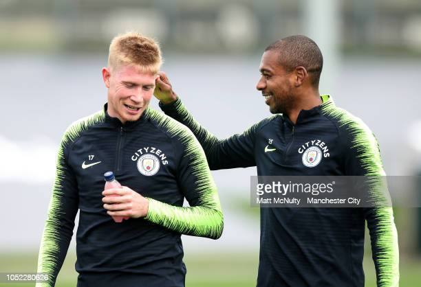 Manchester City's Fernandinho and Kevin de Bruyne during the training session at Manchester City Football Academy on October 16 2018 in Manchester...