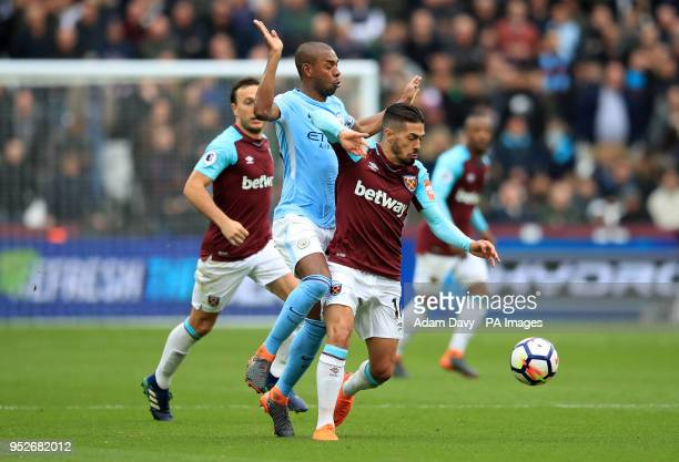 Manchester City's Fernandinho and West Ham United's Manuel Lanzini battle for the ball during the Premier League match at The London Stadium London