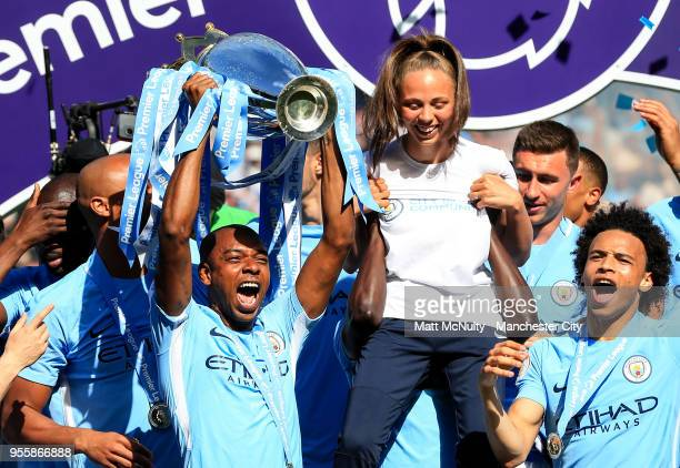 Manchester City's Fernandinho celebrates with the Premier League trophy after the Premier League match between Manchester City and Huddersfield Town...