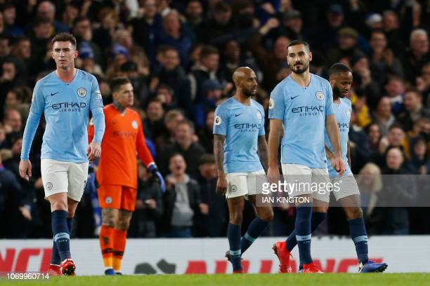 Manchester City's French defender Aymeric Laporte and Manchester City's German midfielder Ilkay Gundogan react after Chelsea scored their second goal...