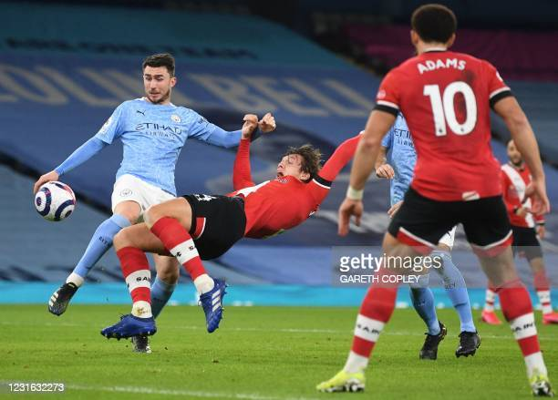 Manchester City's French defender Aymeric Laporte brings down Southampton's Danish defender Jannik Vestergaard and a penalty is awarded during the...
