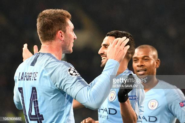 Manchester City's French defender Aymeric Laporte celebrates with teammates after scoring a goal during the UEFA Champions League football match...