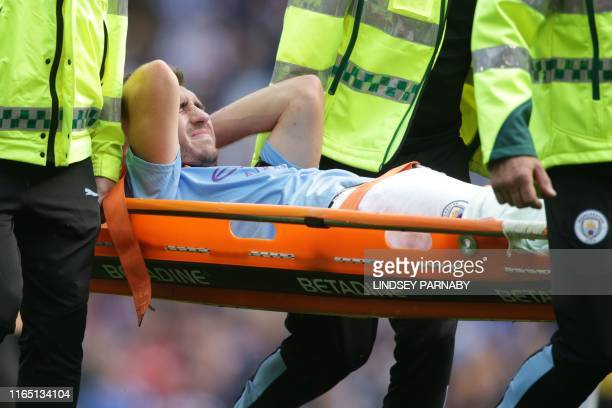 Manchester City's French defender Aymeric Laporte is taken off on a stretcher after picking up an injury during the English Premier League football...