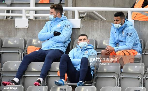 Manchester City's French defender Aymeric Laporte , Manchester City's English midfielder Phil Foden and Manchester City's Algerian midfielder Riyad...