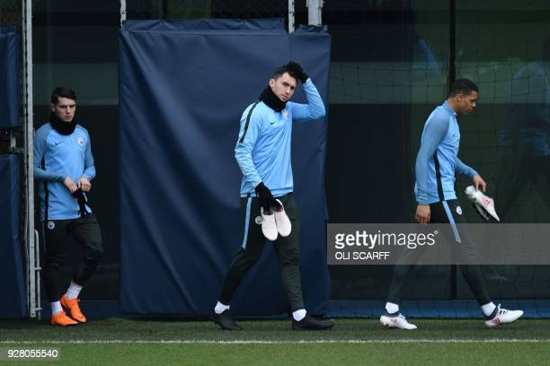 Manchester City's French defender Aymeric Laporte participates in a team training session at the City Football Academy in Manchester north west...