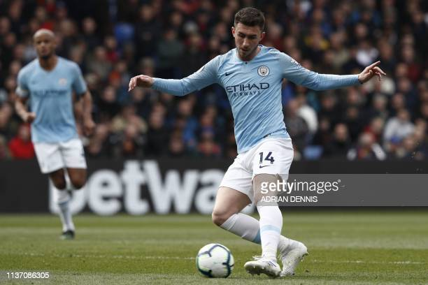 Manchester City's French defender Aymeric Laporte passes the ball during the English Premier League football match between Crystal Palace and...