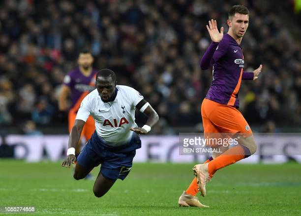 TOPSHOT Manchester City's French defender Aymeric Laporte reacts after fouling Tottenham Hotspur's French midfielder Moussa Sissoko during the...