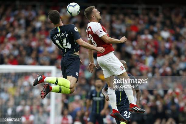 Manchester City's French defender Aymeric Laporte vies with Arsenal's Welsh midfielder Aaron Ramsey during the English Premier League football match...