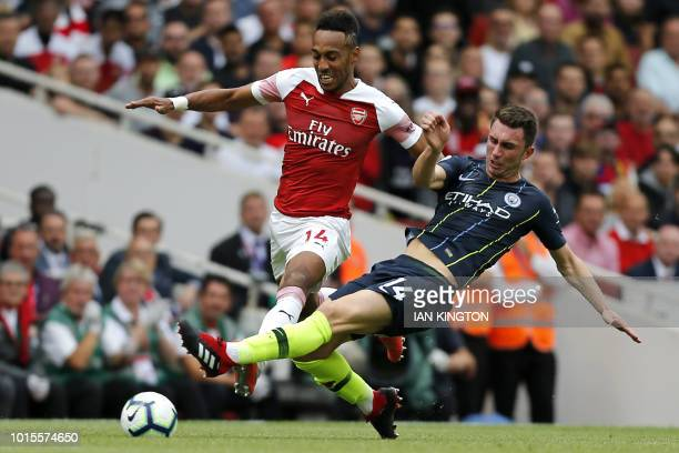 Manchester City's French defender Aymeric Laporte vies with Arsenal's Gabonese striker PierreEmerick Aubameyang during the English Premier League...