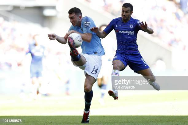 Manchester City's French defender Aymeric Laporte vies with Chelsea's Spanish midfielder Pedro during the English FA Community Shield football match...