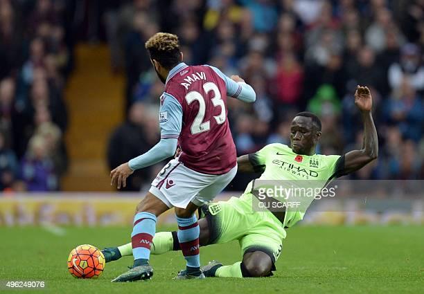 Manchester City's French defender Bacary Sagna tackles Aston Villa's French defender Jordan Amavi during the English Premier League football match...