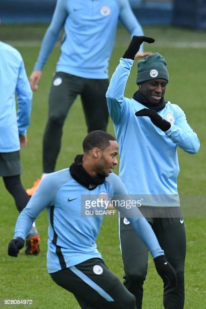 Manchester City's French defender Benjamin Mendy and Manchester City's English midfielder Raheem Sterling participate in a team training session at...