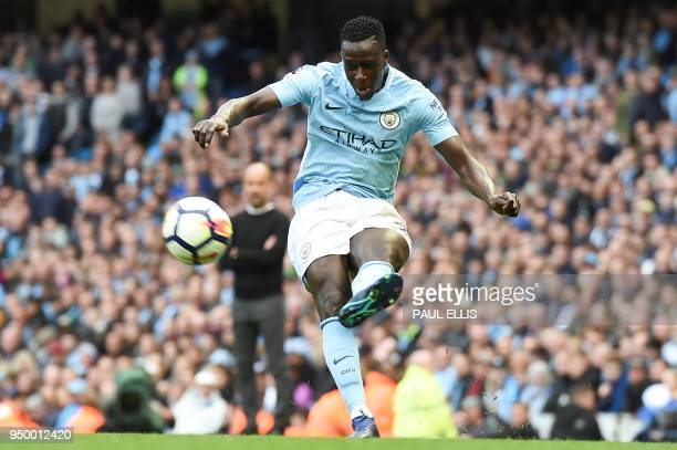 Manchester City's French defender Benjamin Mendy controls the ballduring the English Premier League football match between Manchester City and...