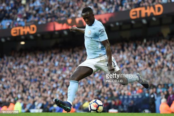 Manchester City's French defender Benjamin Mendy crosses the ball during the English Premier League football match between Manchester City and...