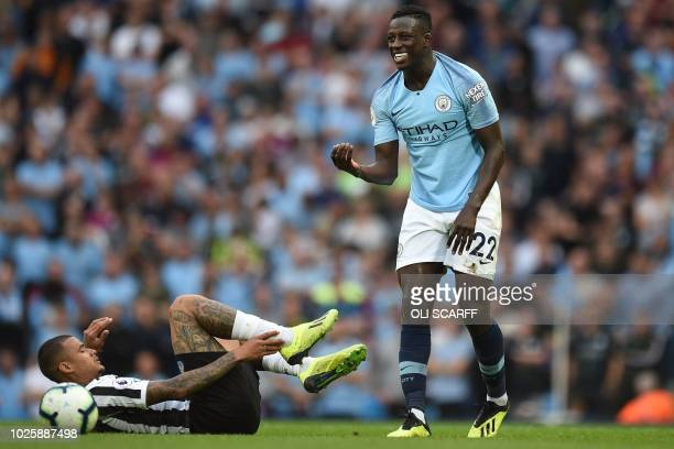 Manchester City's French defender Benjamin Mendy gestures after a clash with Newcastle United's Brazilian midfielder Kenedy during the English...