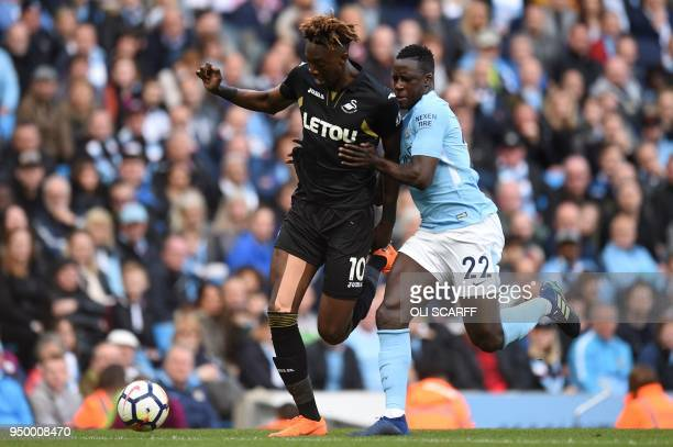 Manchester City's French defender Benjamin Mendy vies with Chelsea's Belgian midfielder Eden Hazard during the English Premier League football match...