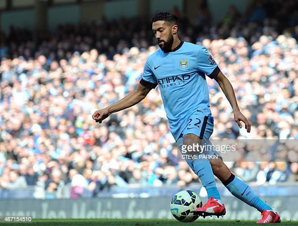 Manchester City's French defender Gael Clichy plays the ball during the English Premier League football match between Manchester City and West...