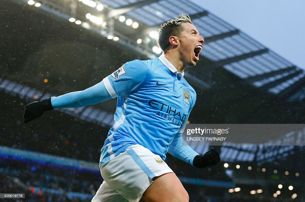 Manchester Citys French midfielder Samir Nasri celebrates after scoring during the English Premier League football match between Manchester City and West Bromwich Albion at the Etihad Stadium in Manchester, north west England, on April 9, 2016. / AFP / LINDSEY PARNABY / RESTRICTED TO EDITORIAL USE. No use with unauthorized audio, video, data, fixture lists, club/league logos or 'live' services. Online in-match use limited to 75 images, no video emulation. No use in betting, games or single club/league/player publications. /