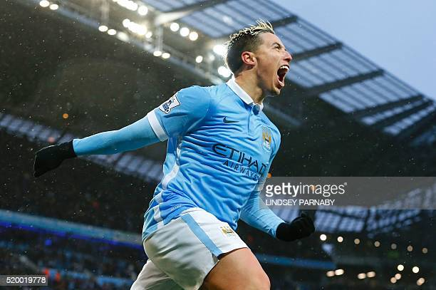 Manchester Citys French midfielder Samir Nasri celebrates after scoring during the English Premier League football match between Manchester City and...