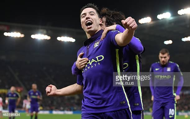 Manchester City's French midfielder Samir Nasri celebrates with Manchester City's Spanish midfielder David Silva after scoring their fourth goal...