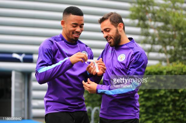 Manchester City's Gabriel Jesus and Bernardo Silva laugh during training at Manchester City Football Academy on August 07 2019 in Manchester England