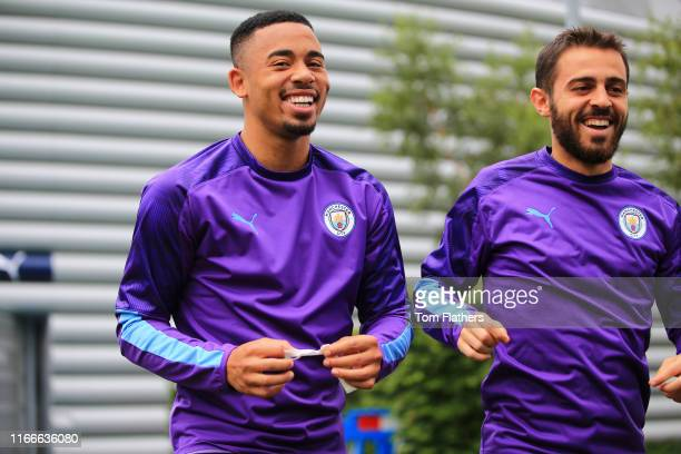 Manchester City's Gabriel Jesus and Bernardo Silva laugh during training at Manchester City Football Academy on August 07, 2019 in Manchester,...