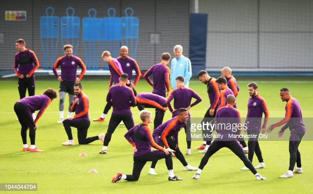 Manchester City's Gabriel Jesus and teammates stretch during training at Manchester City Football Academy on October 1, 2018 in Manchester, England.