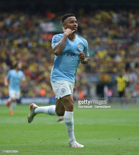 Manchester City's Gabriel Jesus celebrates scoring his side's fourth goal during the FA Cup Final match between Manchester City and Watford at...