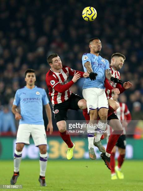 Manchester City's Gabriel Jesus competes with Sheffield United's John Fleck and Oliver Norwood during the Premier League match between Sheffield...