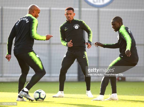 Manchester City's Gabriel Jesus Vincent Kompany and Benjamin Mendy in action during training at Manchester City Football Academy on October 19 2018...