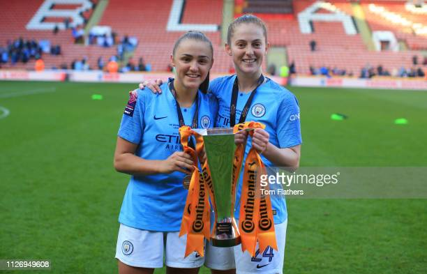 Manchester City's Georgia Stanway and Keira Walsh celebrate winning the Continental League Cup Final at Bramall Lane on February 23 2019 in Sheffield...