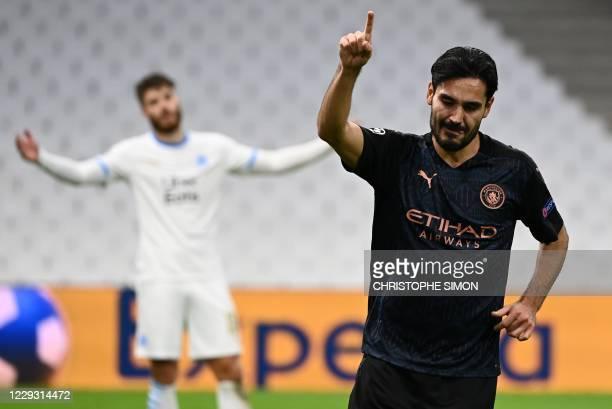Manchester City's German midfielder Ilkay Gundogan celebrates after scoring a goal during the UEFA Champions League Group C football match between...