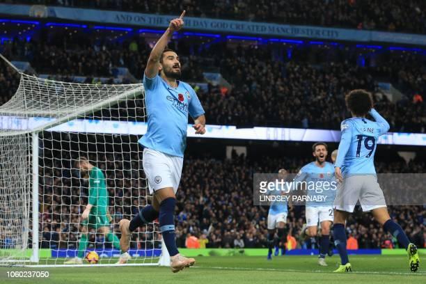 Manchester City's German midfielder Ilkay Gundogan celebrates after scoring their third goal during the English Premier League football match between...