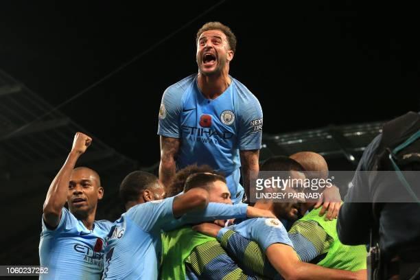 TOPSHOT Manchester City's German midfielder Ilkay Gundogan celebrates after scoring their third goal during the English Premier League football match...