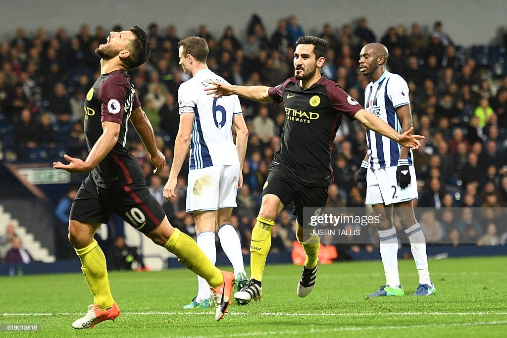 Manchester City's German midfielder Ilkay Gundogan (2nd R) celebrates after scoring their fourth goal during the English Premier League football match between West Bromwich Albion and Manchester City at The Hawthorns stadium in West Bromwich, central England, on October 29, 2016. Manchester City won the game 4-0. / AFP / Justin TALLIS / RESTRICTED TO EDITORIAL USE. No use with unauthorized audio, video, data, fixture lists, club/league logos or 'live' services. Online in-match use limited to 75 images, no video emulation. No use in betting, games or single club/league/player publications. /
