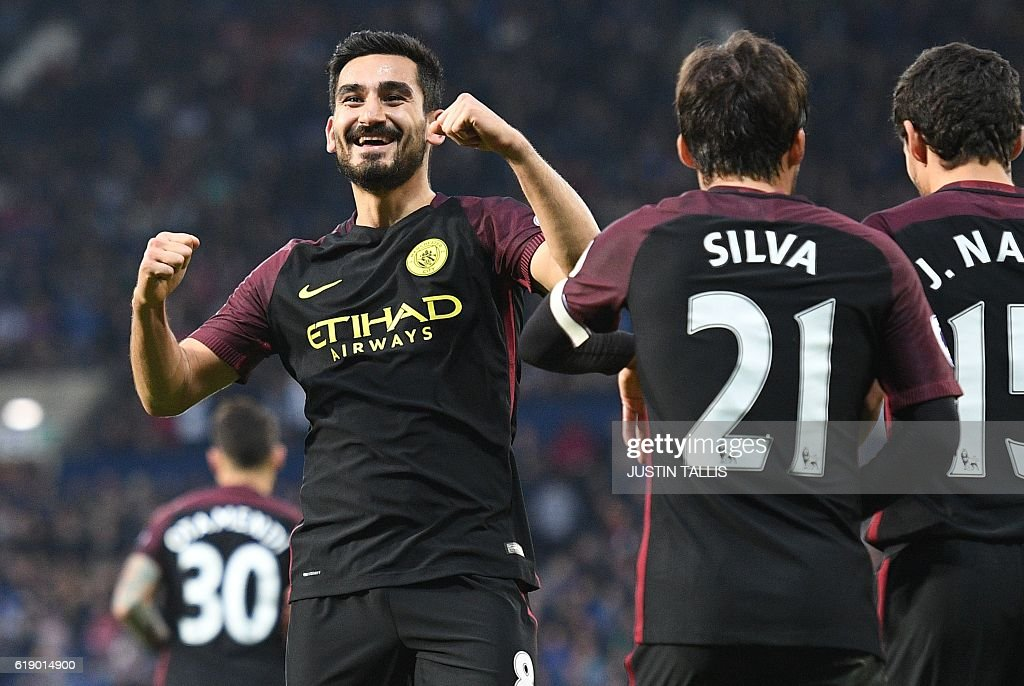Manchester City's German midfielder Ilkay Gundogan (L) celebrates after scoring their third goal during the English Premier League football match between West Bromwich Albion and Manchester City at The Hawthorns stadium in West Bromwich, central England, on October 29, 2016. Manchester City won the game 4-0. / AFP / Justin TALLIS / RESTRICTED TO EDITORIAL USE. No use with unauthorized audio, video, data, fixture lists, club/league logos or 'live' services. Online in-match use limited to 75 images, no video emulation. No use in betting, games or single club/league/player publications. /