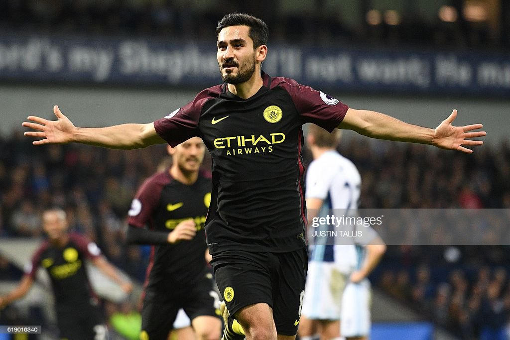 Manchester City's German midfielder Ilkay Gundogan celebrates after scoring their third goal during the English Premier League football match between West Bromwich Albion and Manchester City at The Hawthorns stadium in West Bromwich, central England, on October 29, 2016. Manchester City won the game 4-0. / AFP / Justin TALLIS / RESTRICTED TO EDITORIAL USE. No use with unauthorized audio, video, data, fixture lists, club/league logos or 'live' services. Online in-match use limited to 75 images, no video emulation. No use in betting, games or single club/league/player publications. /