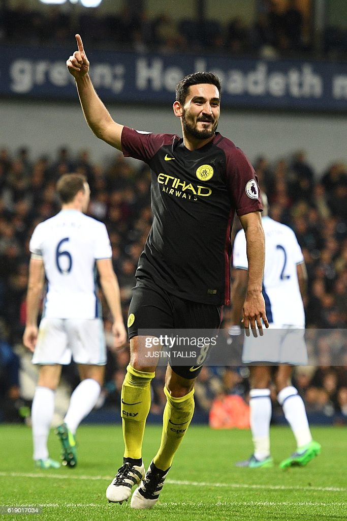 Manchester City's German midfielder Ilkay Gundogan celebrates after scoring their fourth goal during the English Premier League football match between West Bromwich Albion and Manchester City at The Hawthorns stadium in West Bromwich, central England, on October 29, 2016. Manchester City won the game 4-0. / AFP / Justin TALLIS / RESTRICTED TO EDITORIAL USE. No use with unauthorized audio, video, data, fixture lists, club/league logos or 'live' services. Online in-match use limited to 75 images, no video emulation. No use in betting, games or single club/league/player publications. /