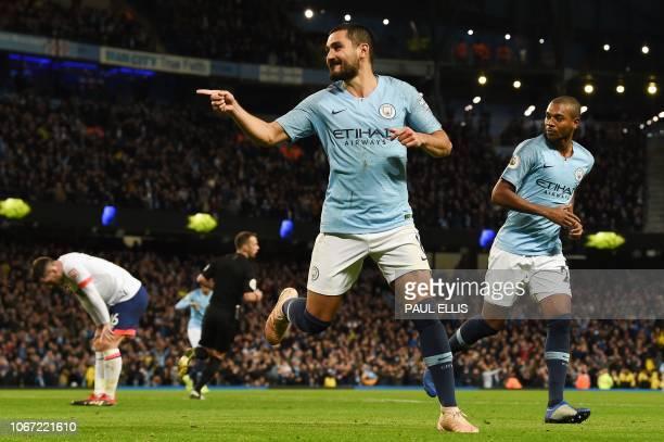 Manchester City's German midfielder Ilkay Gundogan celebrates scoring their third goal for 31 during the English Premier League football match...