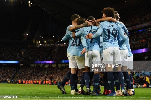 Manchester City's German midfielder Ilkay Gundogan celebrates scoring their third goal for 31 with teammates during the English Premier League...