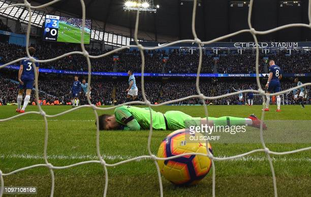 Manchester City's German midfielder Ilkay Gundogan celebrates scoring his team's fourth goal as Chelsea's Spanish goalkeeper Kepa Arrizabalaga reacts...