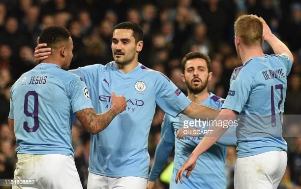 Manchester City's German midfielder Ilkay Gundogan celebrates scoring the opening goal during the UEFA Champions League football Group C match...