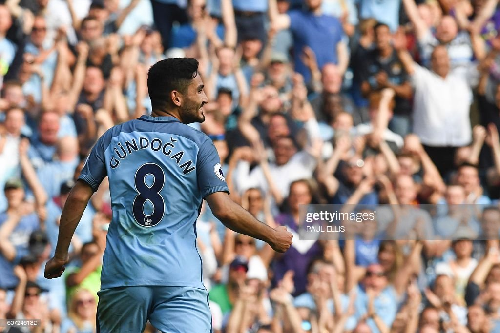 Manchester City's German midfielder Ilkay Gundogan celebrates scoring their fourth goal during the English Premier League football match between Manchester City and Bournemouth at the Etihad Stadium in Manchester, north west England, on September 17, 2016. / AFP / PAUL ELLIS / RESTRICTED TO EDITORIAL USE. No use with unauthorized audio, video, data, fixture lists, club/league logos or 'live' services. Online in-match use limited to 75 images, no video emulation. No use in betting, games or single club/league/player publications. /
