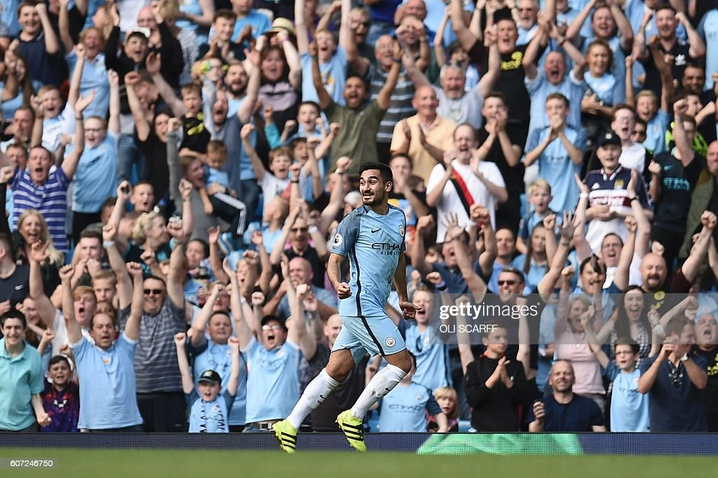 Manchester City's German midfielder Ilkay Gundogan celebrates scoring their fourth goal during the English Premier League football match between Manchester City and Bournemouth at the Etihad Stadium in Manchester, north west England, on September 17, 2016. / AFP / OLI SCARFF / RESTRICTED TO EDITORIAL USE. No use with unauthorized audio, video, data, fixture lists, club/league logos or 'live' services. Online in-match use limited to 75 images, no video emulation. No use in betting, games or single club/league/player publications. /