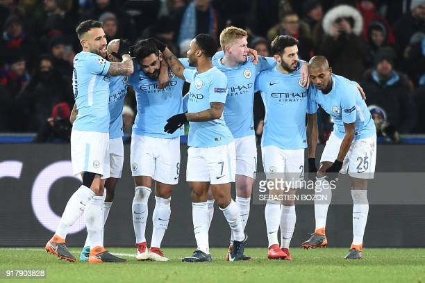 TOPSHOT Manchester City's German midfielder Ilkay Gundogan celebrates with teammates after scoring his second goal during the UEFA Champions League...