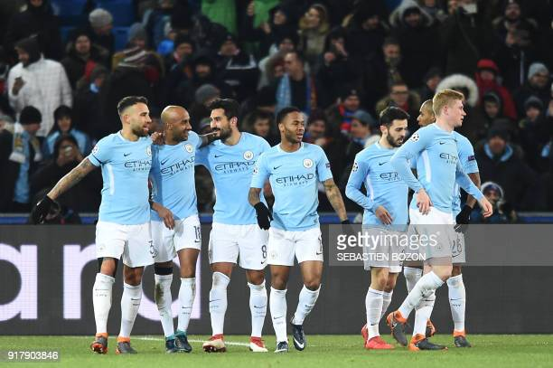 Manchester City's German midfielder Ilkay Gundogan celebrates with teammates after scoring his second goal during the UEFA Champions League round of...